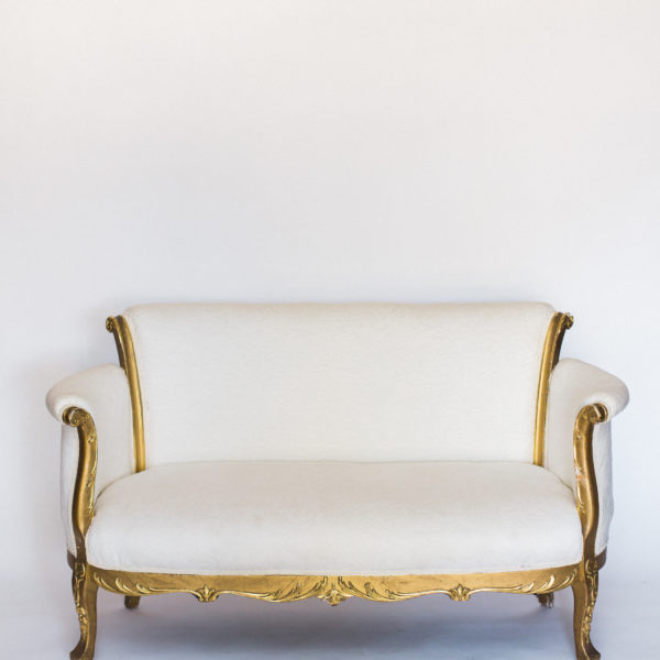 white and gold couch