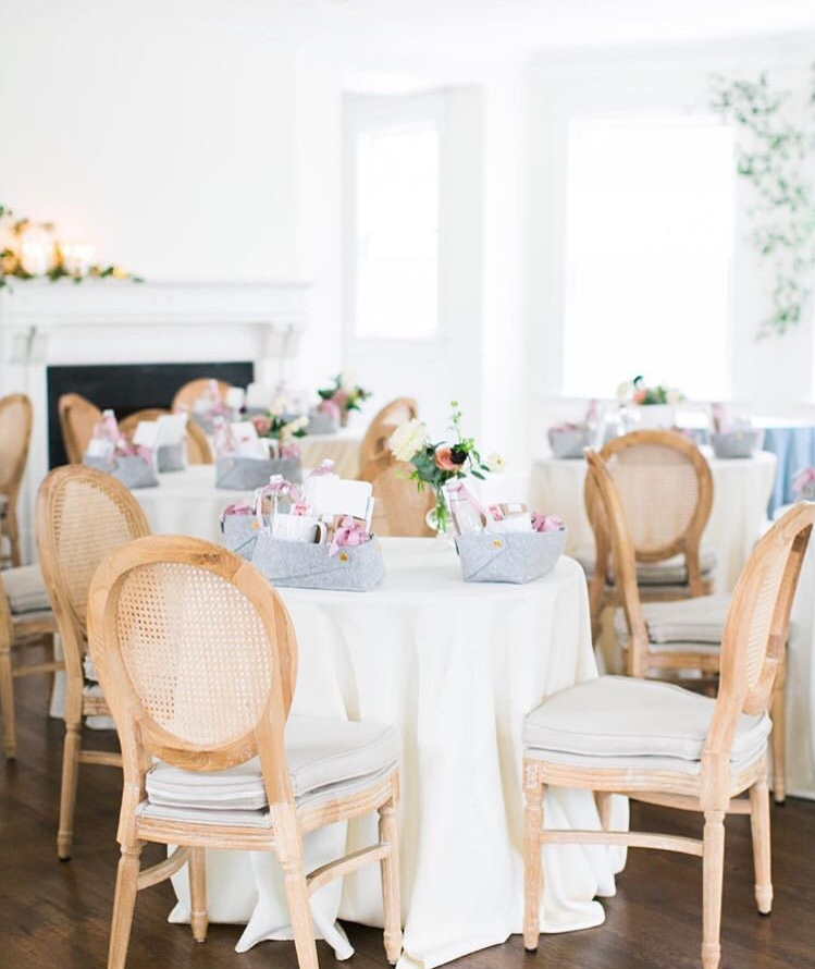linen chairs at small tables