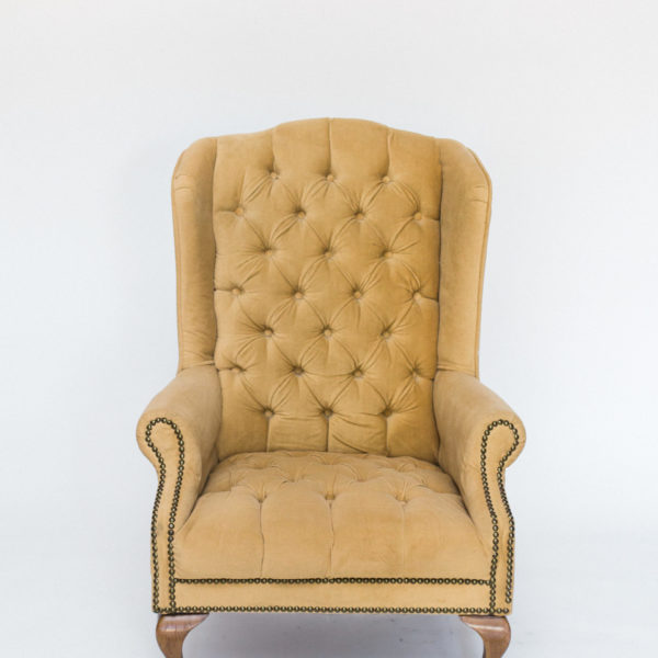tan velvet wingback chair