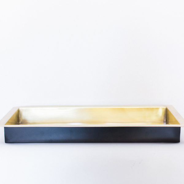 gold and black tray