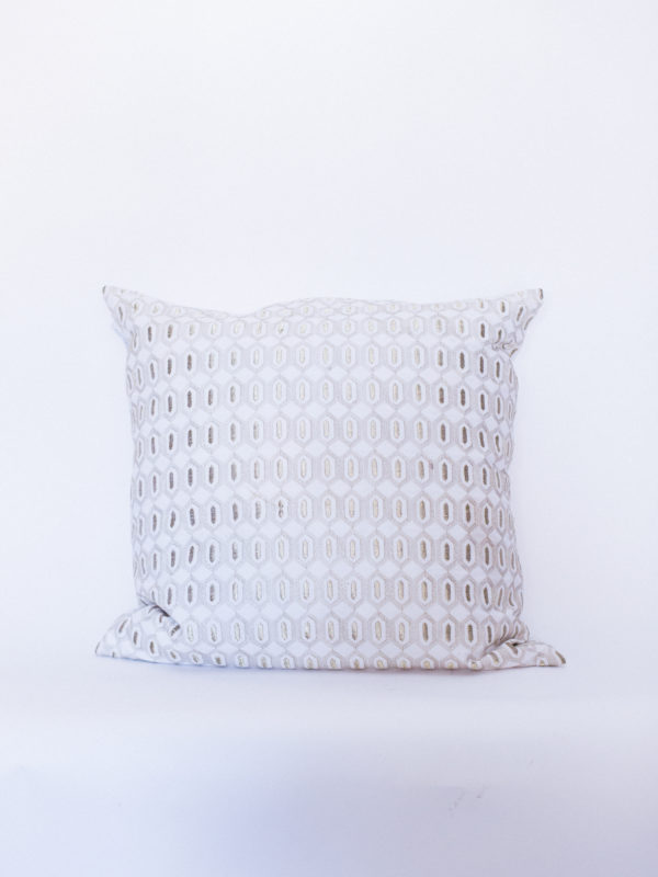 white and gold pillow