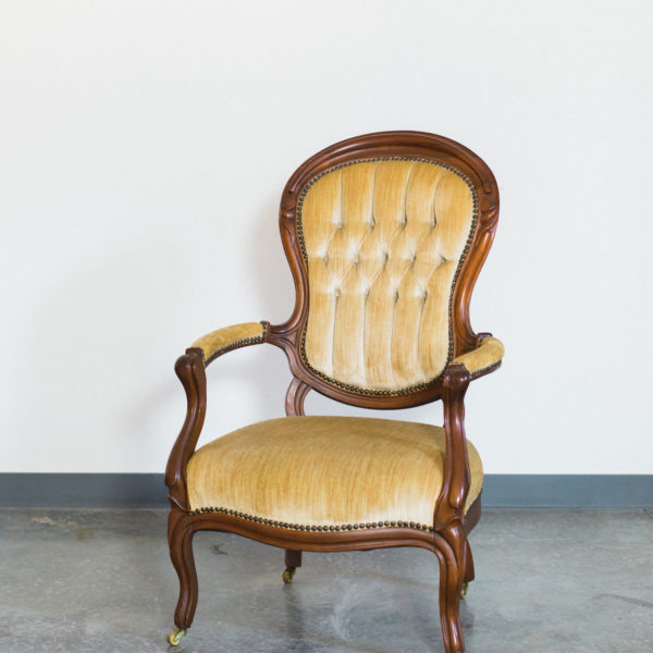 yellow vintage chair with arms